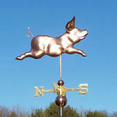 Happy Pig Weathervane right side view on blue sky background