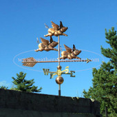 Three Flying Pigs Weathervane right side view on blue sky background