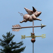 Small Flying Pig Weathervane right side view on gray-blue sky background
