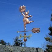 dancing pig with four leaf clover weathervane left side view on blue sky background