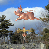 Super Pig Weathervane left side view on blue and white cloudy sky background