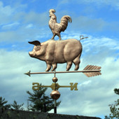 Pig and Rooster Weathervane left side view on blue and cloudy sky background