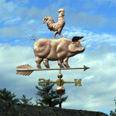 Pig and Rooster Weathervane right front side view on blue and cloudy sky background