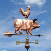 rooster and pig weathervane side view image on blue sky
