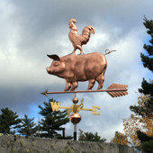 side view of pig and chicken weathervane on stormy background image