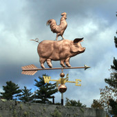 back side of pig and rooster weathervane standing on arrow on stormy background image