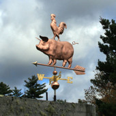 pig with rooster on its back weathervane  slight left front  view on stormy background