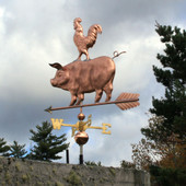 pig with rooster on its back weathervane  left rear view on stormy background
