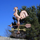 Crowing Rooster Weathervane left side view on blue sky background