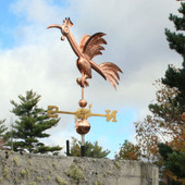Fun Rooster Weathervane Front View on Blue and Cloudy Sky Background