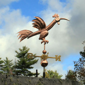 Fun Rooster Weathervane Right Side View on Stormy Sky Background