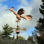 Fun Rooster Weathervane Left Side View on Stormy Sky Background