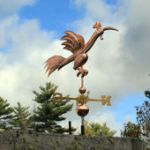 Fun Rooster Weathervane Right Angle View on Stormy Sky Background