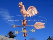 Big Rooster Weathervane left side view on blue sky background