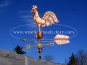 Rooster Weathervane Left Side View on Blue Sky Background