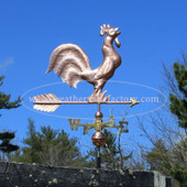 Rooster Weathervane right side view on blue sky background