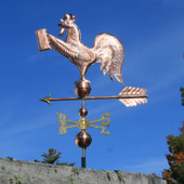 rooster weathervane holding a beer mug left side view on blue sky background