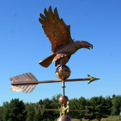 American Eagle Weathervane right side view on blue and cloudy sky background