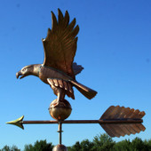 American Eagle Weathervane left view on blue and cloudy sky background