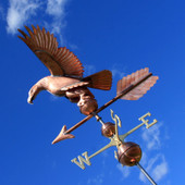 Eagle Weathervane underside view on blue sky background