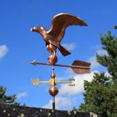 golden eagle weathervane left side view on blue sky background