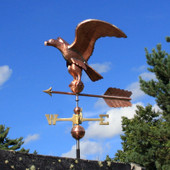 Golden Eagle Weathervane left side view on blue sky background