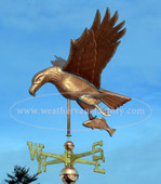 Eagle and Fish Weathervane left side view on blue sky background