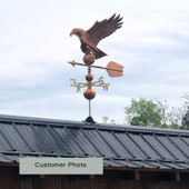 Customer photo of large Eagle Weathervane side view on gray sky background.