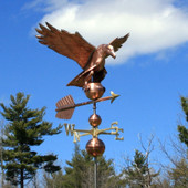 Large Barn Eagle Weathervane front view on blue and cloudy sky background.