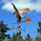 Eagle Weathervane rear view on blue and cloudy sky background.