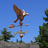 eagle weathervane right side view on blue sky background