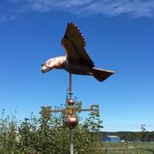 Soaring Eagle Weathervane left side view on blue sky background