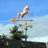 rearing horse weathervane right side view on blue sky background