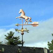 horse weathervane left side view on blue sky background