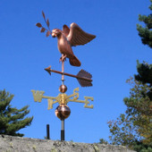 dove weathervane carrying an olive branch front view on blue sky background