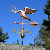 dove weathervane carrying an olive branch left angle view on blue sky background
