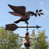 dove weathervane carrying an olive branch close right front angle view on blue sky background