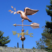 dove weathervane carrying an olive branch left side view on blue sky background