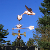 Hummingbird with Flower Weathervane shown left rear view on blue sky background.