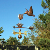 Hummingbird with Flower Weathervane shown left front view on light blue sky background.