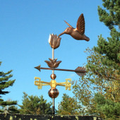 Hummingbird with Flower Weathervane shown front view on light blue sky background.