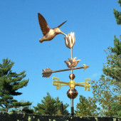 Hummingbird with Flower Weathervane right  front view on light blue sky background.
