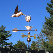 Hummingbird with Flower Weathervane shown right side view on blue sky background.