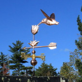 Hummingbird with Flower Weathervane shown left angle view on blue sky background.