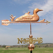 Loon and Chicks  Weathervane on cloudy sky with scrolled directionals image