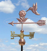 hummingbird weathervane side view on cloudy background image