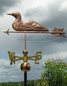 Loon Weathervane left side view on cloudy background