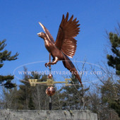 flying pheasant weathervane left front view on blue sky background
