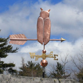 great horned owl weathervane right side view with cloudy background