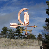 Owl in Moon Weathervane right side on blue sky background.